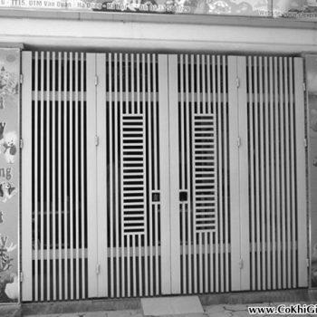 Mẫu cửa cổng sắt giả gỗ 4 cánh CK60 giá Tốt tại TpHCM chỉ từ 900k/m²
